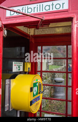 Defibrillator in a Red, traditional, Telephone Box in Grasmere, in the Lake District National Park - Stock Photo