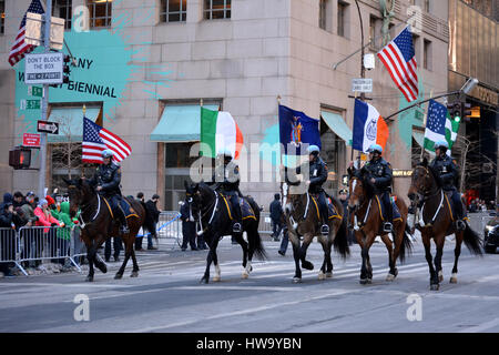 NYPD on horseback leading the New York City St. Patrick's Day Parade up Fifth Avenue. - Stock Photo