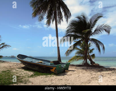 old fishing boat on beach with palm trees North End Big Corn Island Nicaragua Central America - Stock Photo