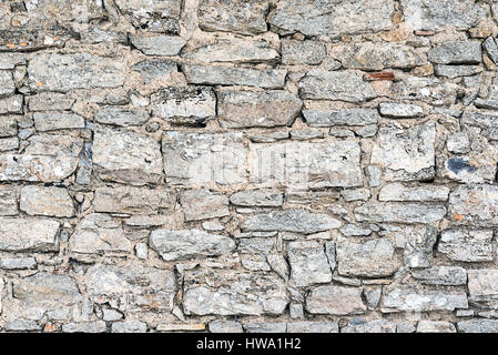 Background from a rough wall made of natural stone - Stock Photo