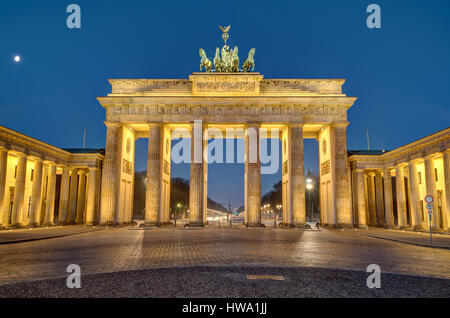 The famous Brandenburg Gate in Berlin at night - Stock Photo