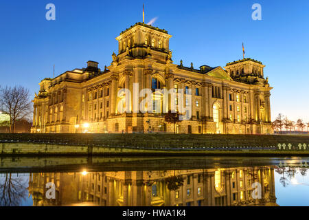The famous Reichstag building at the river Spree in Berlin at night - Stock Photo