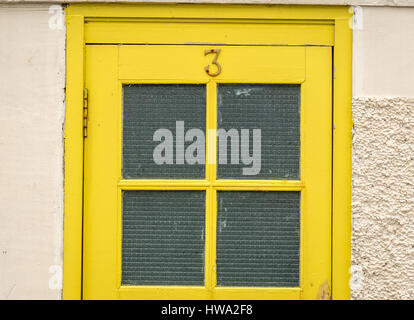 An Old Frosted Glass Window In An Office Door Advertises