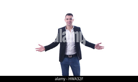 Young smiling but confused businessman looking at camera studio shot - Stock Photo