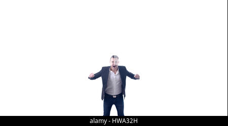 Very angry young businessman raging and screaming at camera. Huge white background,studio shot. - Stock Photo