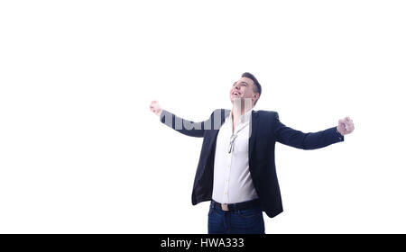 Young happy business man celebrating success with arms outstreched studioshot - Stock Photo