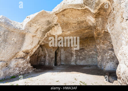 travel to Italy - hall in artificial cave of ancient Greek theater in Archaeological Park (Parco Archeologico della - Stock Photo