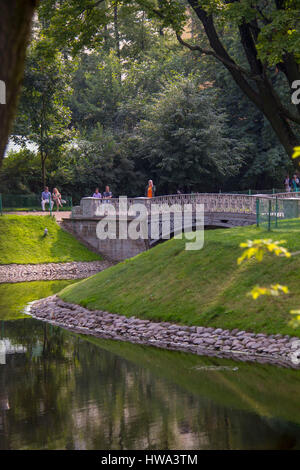 Saint- Petersburg, RUSSIA - July 23, 2016: Cast iron Bridge in Mikhailovsky Garden, idyllic park in central St. - Stock Photo