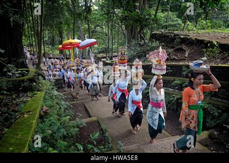 Indonesia, Bali, Ubud, Monkey Forest, Balinese villagers participating in traditional religious Hindu procession, - Stock Photo