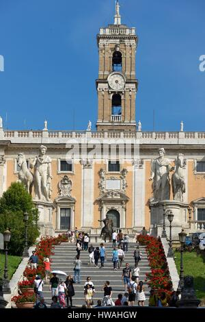 Italy, Lazio, Rome, historical centre listed as World Heritage by UNESCO, district of Roma Antica, walkers on a - Stock Photo