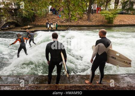 Germany, Bavaria, Munich, Englischer Garten park, Eisbach, river surfing area, fall - Stock Photo