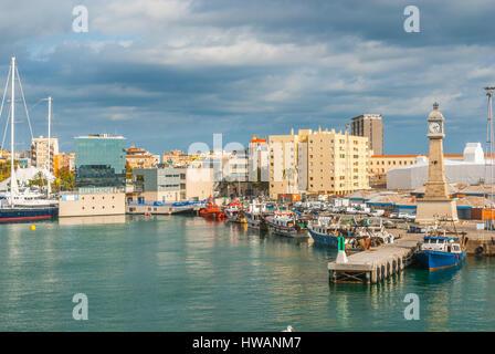 Boats moored in harbor at Port Vell in Barcelona, Spain. Sailboats, yachts, pleasure craft & fishing trawlers docked - Stock Photo