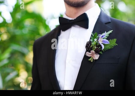 Gentle groom boutonniere with roses, chrysanthemum and beads - Stock Photo