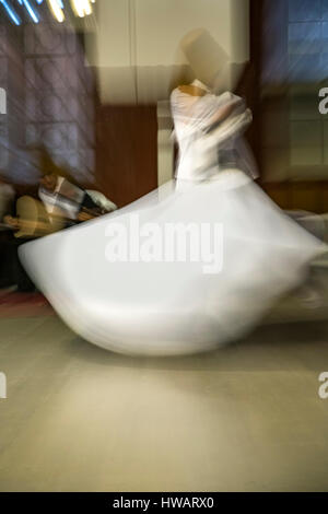 Dancer, whirling dervishes ceremony, Sirkeci Train Station, Istanbul, Turkey - Stock Photo