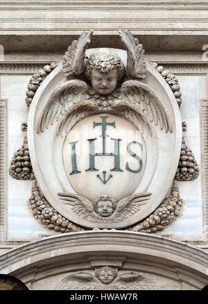Christogram IHS, facade of the Church of the Gesu, mother church of the Society of Jesus, Rome, Italy - Stock Photo