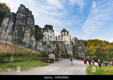 HORN-BAD MEINBERG - OCTOBER 04: The famous sandstone rock formation Externsteine in autumn with some tourists in - Stock Photo