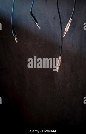 Audio Cables over Dark Background - Stock Photo