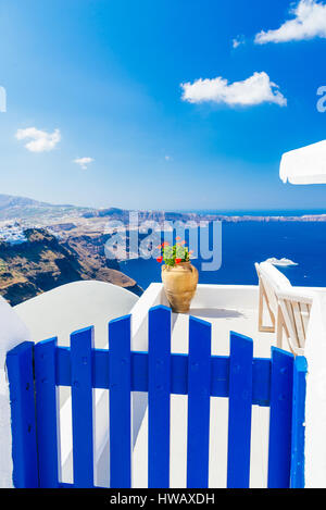 Selective focus on blue with view of volcanic caldera, architectural detail on Imerovigli, Santorini - Stock Photo