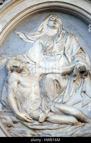Our Lady of Sorrows, bass relief on the facade of Sant Andrea de Urso church in Rome, Italy  on September 02, 2016. - Stock Photo