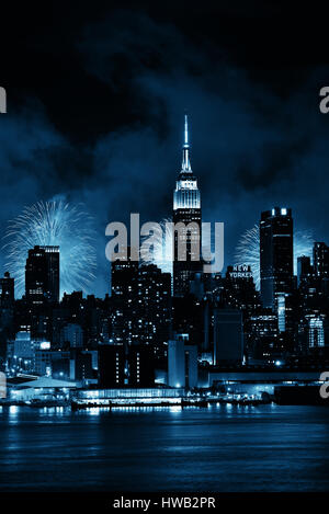 NEW YORK CITY - JUL 4: Empire State Building with fireworks on July 4, 2015 in Manhattan, New York City. With population - Stock Photo