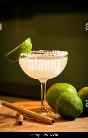 mexican lemon lime margarita tequila cocktail drink in modern bar - Stock Photo