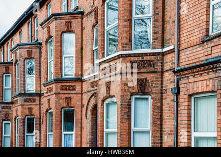 Typical Victorian three storey houses in Belfast. - Stock Photo