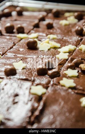A shop bought chocolate tray bake cake. - Stock Photo