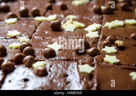 A shop bought chocolate tray bake cake. - Stock Photo