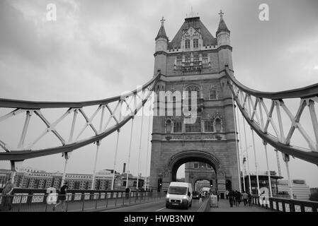 LONDON, UK - SEP 25: Tower Bridge with tourists and traffic on September 25, 2013 in London, UK. It is one of the - Stock Photo
