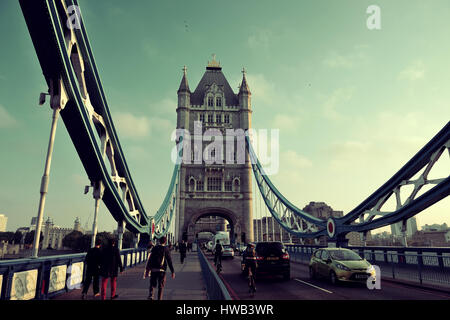 LONDON, UK - SEP 27: Tower Bridge and traffic on September 27, 2013 in London, UK. London is the world's most visited - Stock Photo
