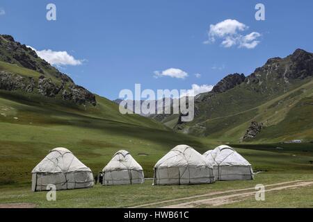 Kyrgyzstan, Naryn Province, sightseeing tour and mountain trek, yurt village - Stock Photo