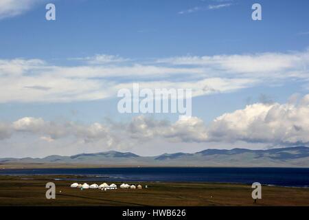 Kyrgyzstan, Naryn Province, sightseeing tour and mountain trek, yurt village on the sacred Song-Koul lake - Stock Photo