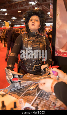 Film and comic fans dressed in the costumes of their favourite characters gather at the Comic Con exhibition at - Stock Photo