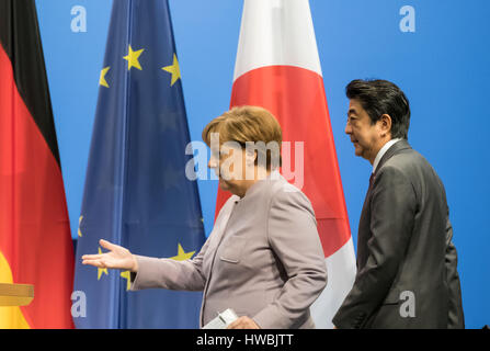 Hanover, Germany. 20th Mar, 2017. German Chancellor Angela Merkel and Japanese Prime Minister Shinzo Abe stand together - Stock Photo