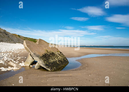 Remains of an old concrete pillbox on the sandy beach at Filey bay, North Yorkshire, England. - Stock Photo