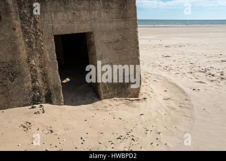 Entrance to an old concrete pillbox on the sandy beach at Filey bay, North Yorkshire, England. - Stock Photo