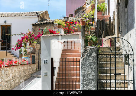 Courtyard with stairs and plants in Taormina at Sicilian Island, Italy - Stock Photo