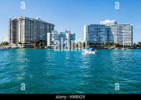 Miami Beach Florida Biscayne Bay water sailboat Belle Isle high rise condominium residential building - Stock Photo