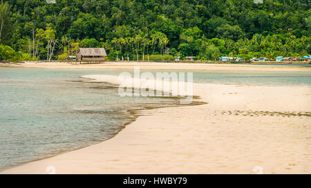 Sandy Bank in front of Local Village on Monsuar Island. Raja Ampat, Indonesia, West Papua - Stock Photo