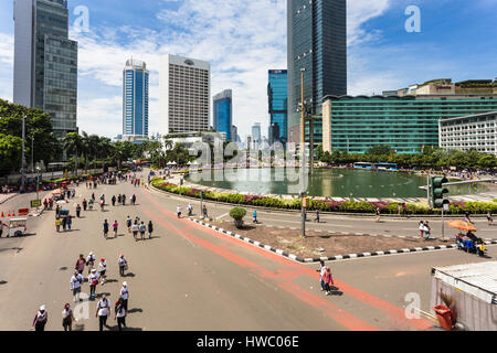 JAKARTA, INDONESIA - SEPTEMBER 25, 2016: People enjoy the car free day, which happens every Sunday morning, on the - Stock Photo