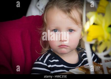 Child Girl Upset Tearful Pout Pouting Direct Gaze - Stock Photo