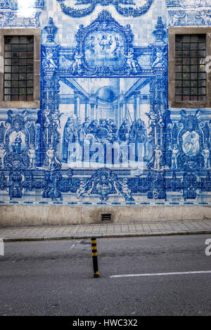 Azulejo ceramic tiles religious scene on a facade of Capela das Almas (also called Capela das Santa Catarina) - - Stock Photo