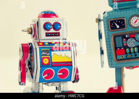 Filtered vintage tin toy robots isolated on white background - Stock Photo