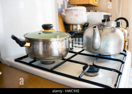 Pot and kettle on a gas stove 2 - Stock Photo