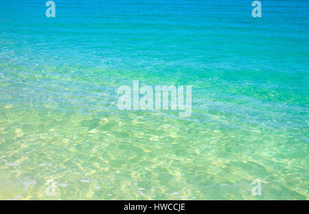 Cristal clear turquoise waters at Ffryes Beach, SW Antigua, Antigua and Barbuda - Stock Photo