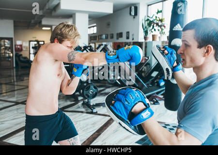 Men practicing boxing in gym - Stock Photo