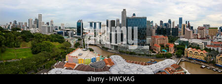Horizontal panoramic (2 picture stitch) cityscape of Singapore with Clarke Quay in the foreground and - Stock Photo
