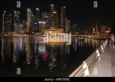 Horizontal view of the skyscrapers of the CBD, central business district, across Marina Bay at night i - Stock Photo