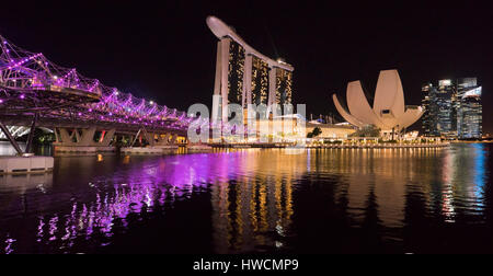 Horizontal panormaic (2 picture stitch) view of the Helix Bridge, Marina Bay Sands Hotel and the ArtSc - Stock Photo