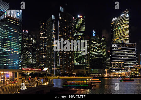 Horizontal view of the Singapore River Cruise terminal in Singapore at night. - Stock Photo
